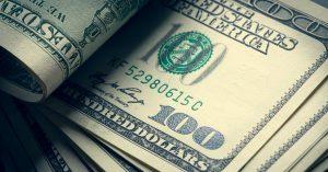 hundred dollar bills in a stack