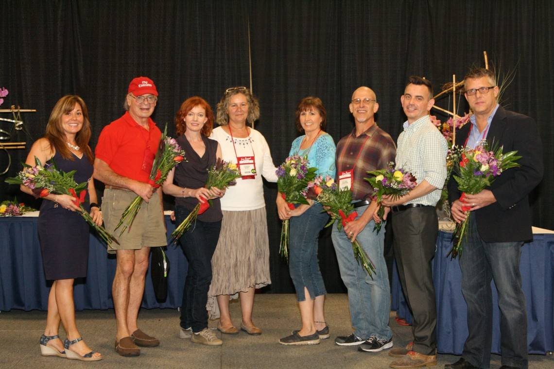 Jan Wemple (third from right) and Michael Thompson (second from right) accept multiple awards on behalf of Moore Landscapes at the annual TPIE Awards in South Florida.