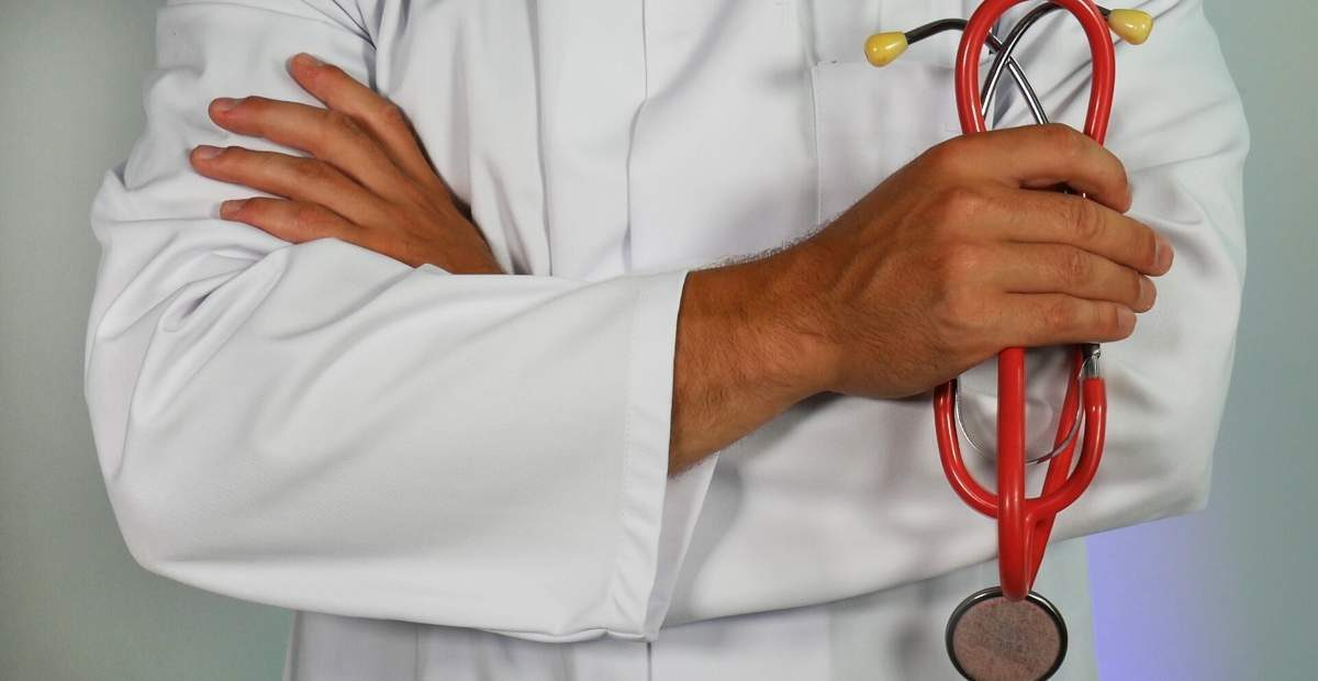 An image of a doctor holding a stethoscope.