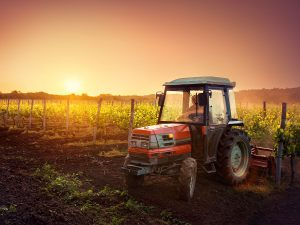 Image of a tractor on a field in a farm