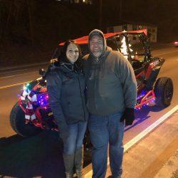 Couple Enjoying Christmas Ride on UTV