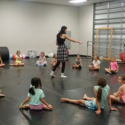 Young Dance Students Sitting in a Circle