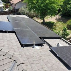 Set of solar panels installed on a grey house roof