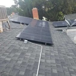 Solar panels installed on an older house roof