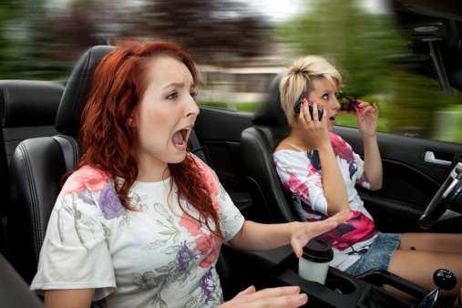 Don't be a distracted driver, especially with zombies in the road!