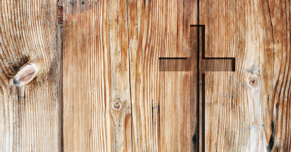 Christian cross carved into wooden door - Narrate Church