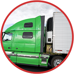 An image of a semi truck with a green cab and white trailer