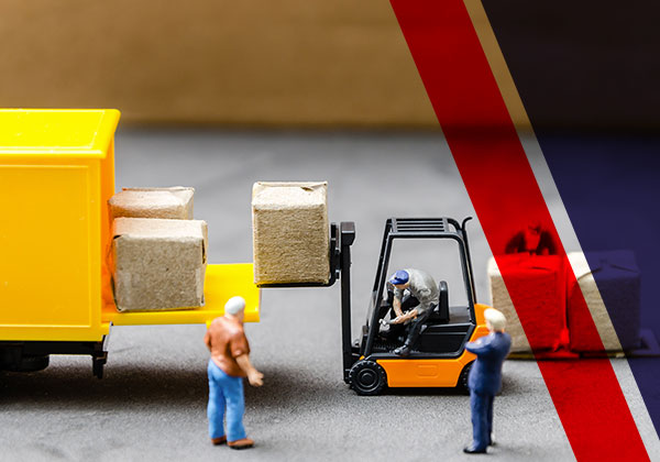 A depiction of a person removing loads with a piece of machinery illustrated with toys.