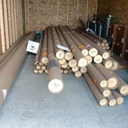 Flag poles in tubes ready for installation - ND Flag Pole Guy