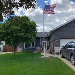 Residential flag pole in a front yard - ND Flag Pole Guy