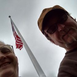 Two guys taking a selfie with their installed American flag pole - ND Flag Pole Guy