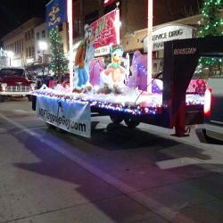 Christmas parade with ND Flag Pole Guy float