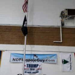 A ND Flag Pole Guy banner hanging in an auditorium