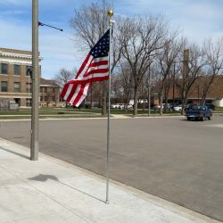 A small American flag pole installed in a commercial space - ND Flag Pole Guy