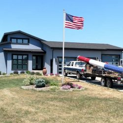 House with flag pole and installation truck - ND Flag Pole Guy