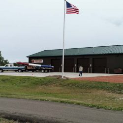 A commercial flag pole installed in front of a fire department - ND Flag Pole Guy