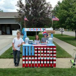 Kids at a lemonade stand with American flag theme - ND Flag Pole Guy