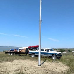 An installed flag pole in a field - ND Flag Pole Guy