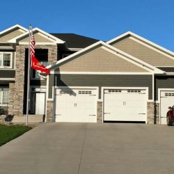 Beautiful house with flag pole with two flags flying - ND Flag Pole Guy