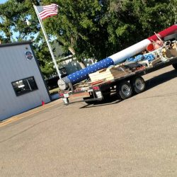A commercial flag pole installed with ND Flag Pole Guy truck