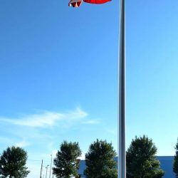 A commercial flag pole installed near a parking lot - ND Flag Pole Guy