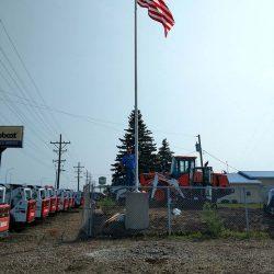 A commercial flag pole installed at a Bobcat dealer - ND Flag Pole Guy