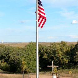 A flag pole being installed in a cemetery - ND Flag Pole Guy