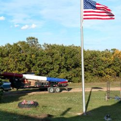 A flag pole installed at a cemetery - ND Flag Pole Guy