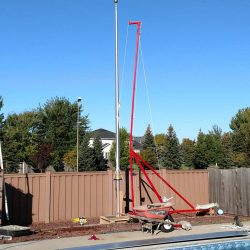 A residential flag pole installed next to a pool - ND Flag Pole Guy