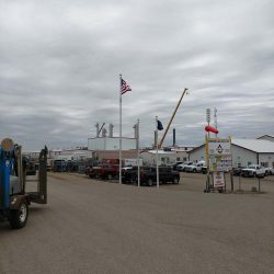 A commercial flag pole installed in a lot - ND Flag Pole Guy