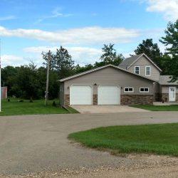 A house with side yard and flag pole - ND Flag Pole Guy
