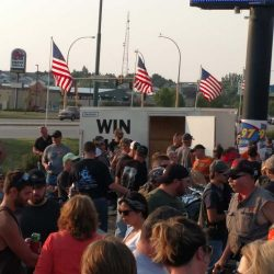 A crowd at an event with American flags - ND Flag Pole Guy