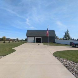 Long driveway with garage and flag pole at the end - ND Flag Pole Guy