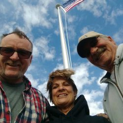 Family taking a selfie in front of a flag pole - ND Flag Pole Guy
