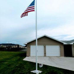 Flag pole installed in a yard - ND Flag Pole Guy