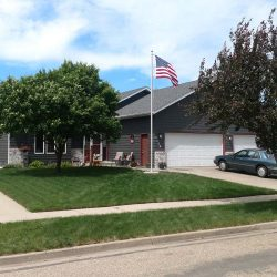 Front yard of a house with an American flag pole - ND Flag Pole Guy