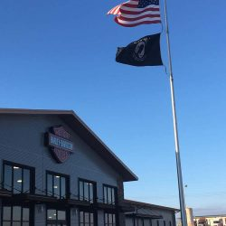 A commercial flag pole installed in front of a Harley-Davidson Motorcycles store - ND Flag Pole Guy