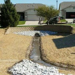 Commercial landscaping retaining wall - New Horizon Landscaping