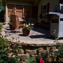 Stone and pavers to make a backyard patio - New Horizon Landscaping