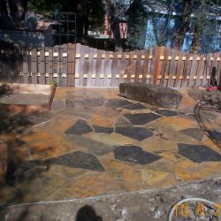 Stone patio with multiple colors and shapes - New Horizon Landscaping
