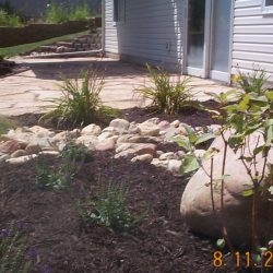 Patio with landscaping - New Horizon Landscaping