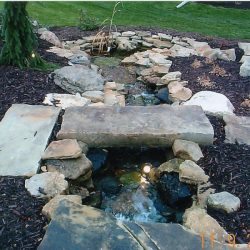 Walkway with water feature and landscaping - New Horizon Landscaping