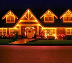 A house lit up with holiday landscaping and decorating services - New Horizon Landscaping