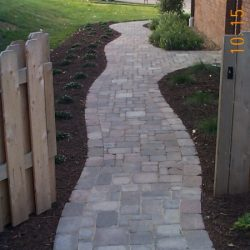 Stone walkway with curves and edging - New Horizon Landscaping