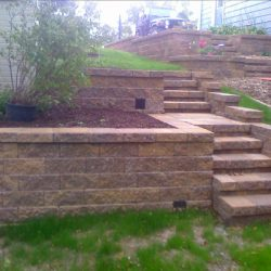 Stone paving wall with steps and landing for multiple levels - New Horizon Landscaping