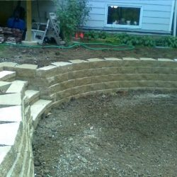 Retaining wall with pavers and steps - New Horizon Landscaping