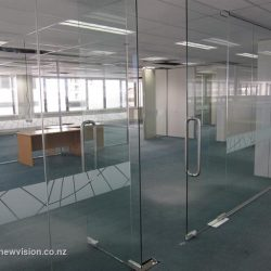 Glass walls separate offices in a stylish manner
