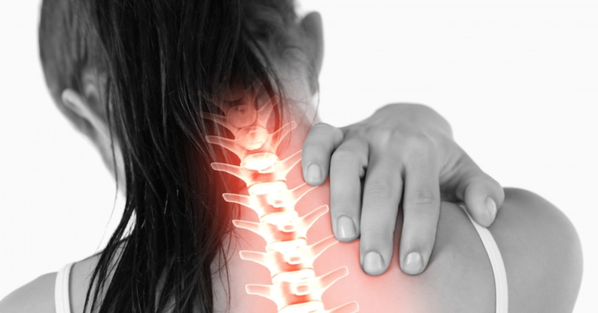 A woman pulls at the muscles in her neck with a spine highlighted.