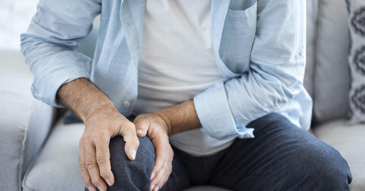A man massaging his knee.