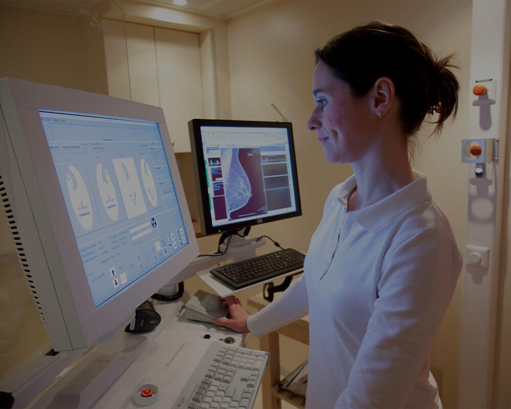 A woman explores medical information in and office.